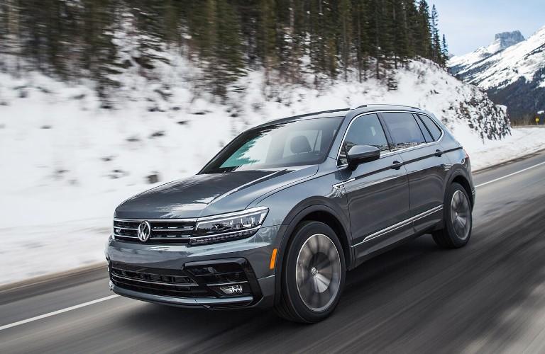 2021 VW Tiguan driving down snowy road