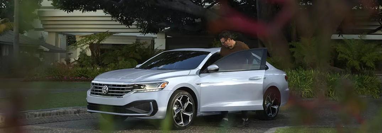 man getting into the 2021 Volkswagen Passat
