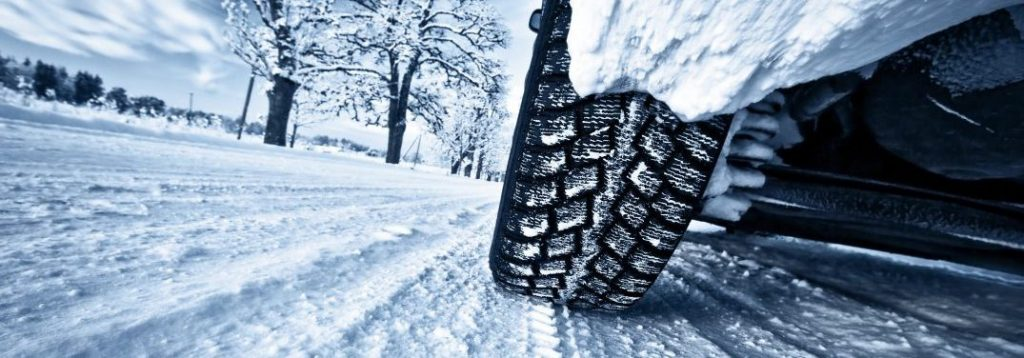 tire driving on snow in winter