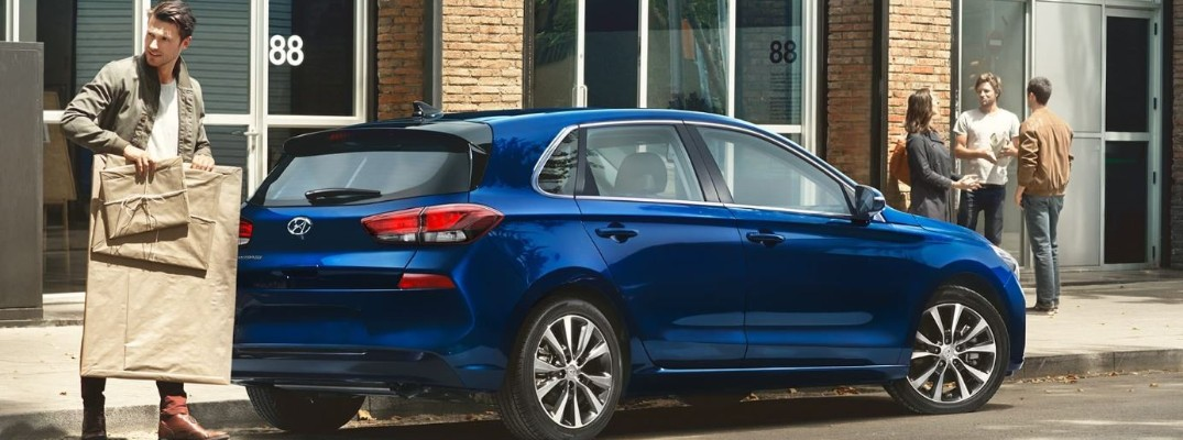 blue hyundai elantra gt in a city