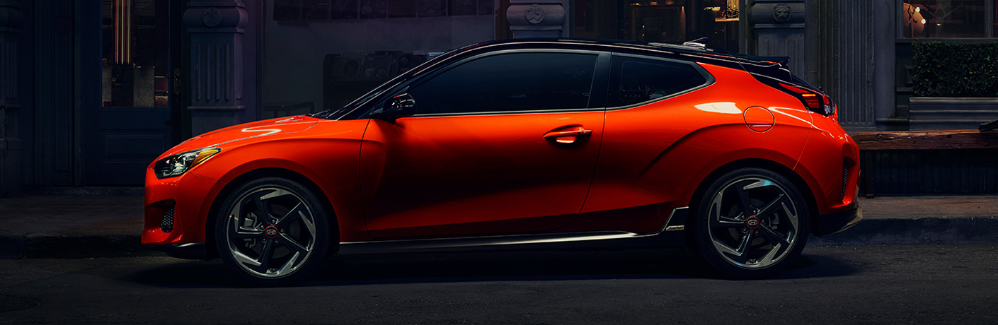 orange hyundai veloster on black