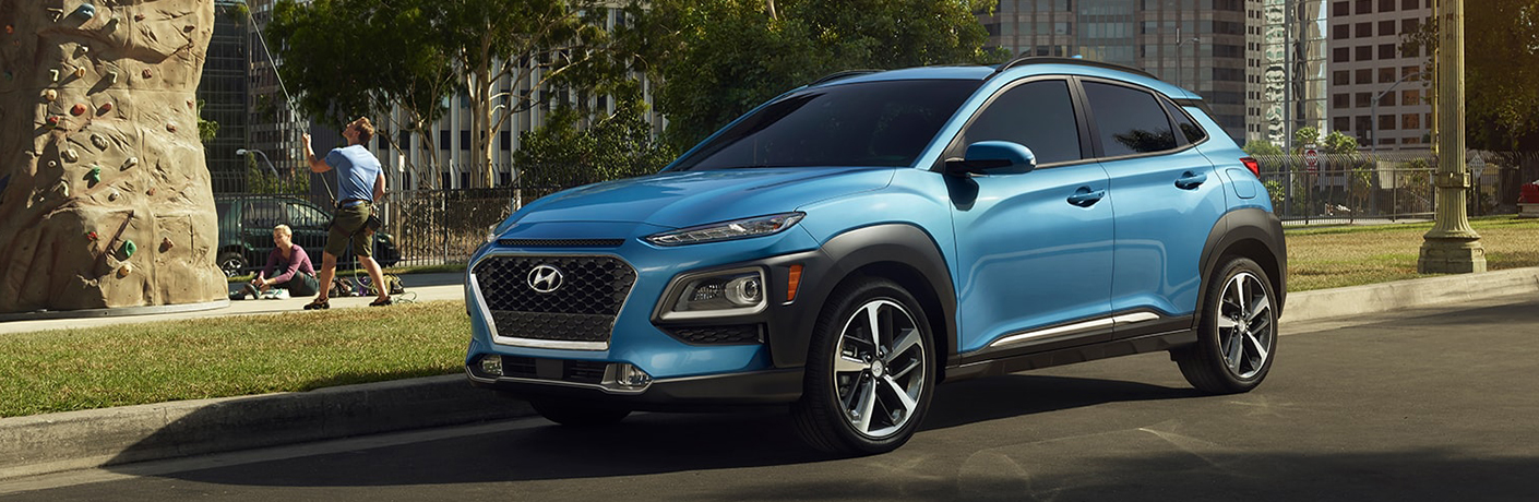 blue hyundai kona side front view