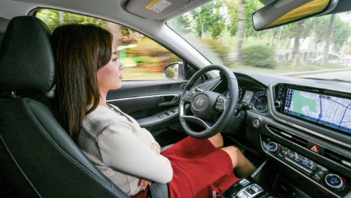 woman using smart cruise control