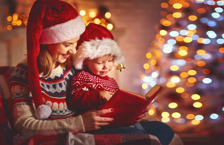 mom and kid with christmas tree