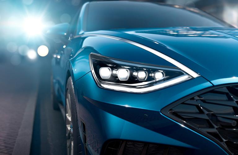 blue hyundai sonata headlight close up