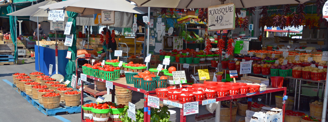Farmers market stalls and vegetables