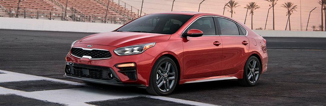 2019 Kia Forte red driving on track