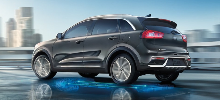 2019 Kia Niro gray side view with blue lights on the road