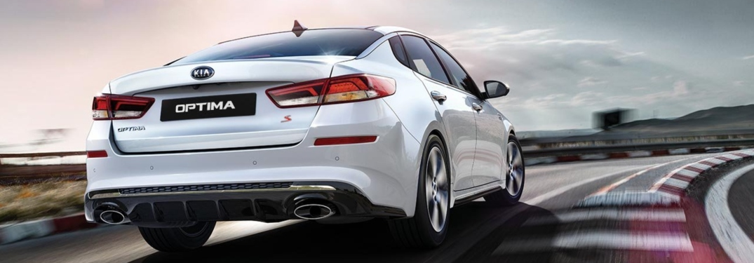 2019 Kia Optima white back view on a track