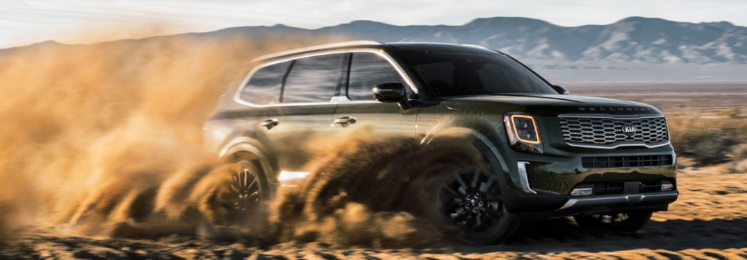2020 Kia Telluride green side view sliding in sand