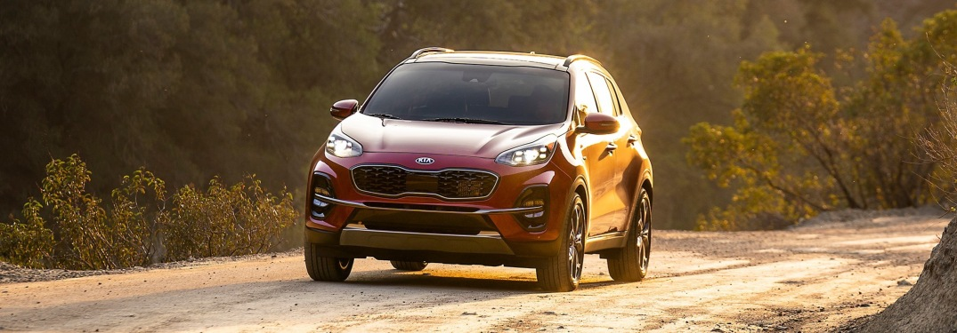 2020 Kia Sportage front view with intense sunlight