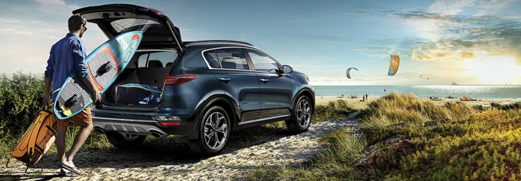 2020 Kia Sportage blue back view loaded with surfboards