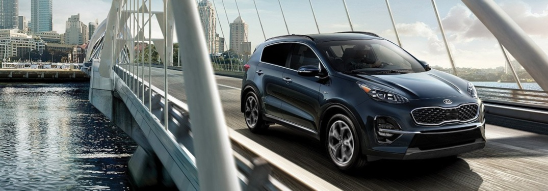 2020 Kia Sportage blue passing over a bridge