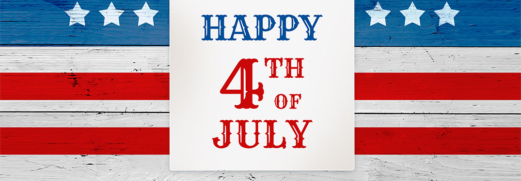 Happy 4th of July on a wood American flag background