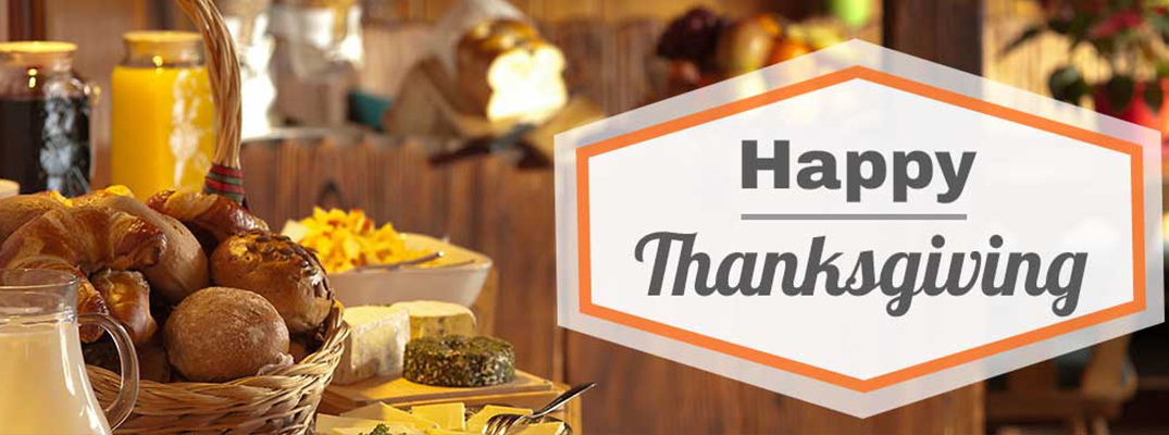 Happy Thanksgiving banner with delicious Thanksgiving food in the background