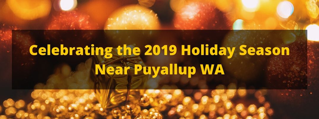 Celebrating the 2019 Holiday Season Near Puyallup WA banner with a background of gold Christmas ornaments