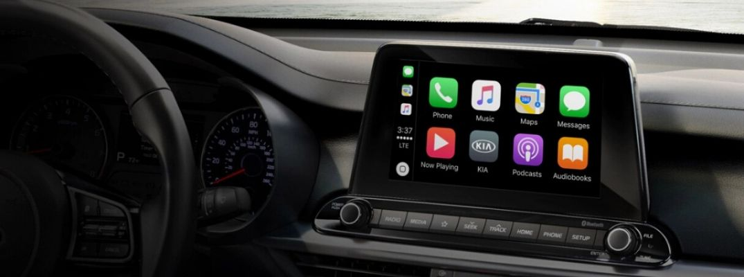 Interior view of Apple CarPlay® on the touchscreen display inside a Kia vehicle