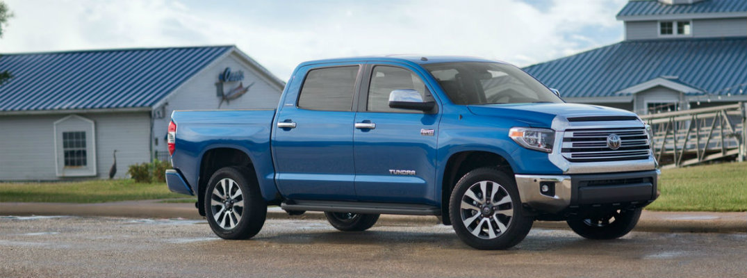 Exterior view of blue 2018 Toyota Tundra parked outside a marina