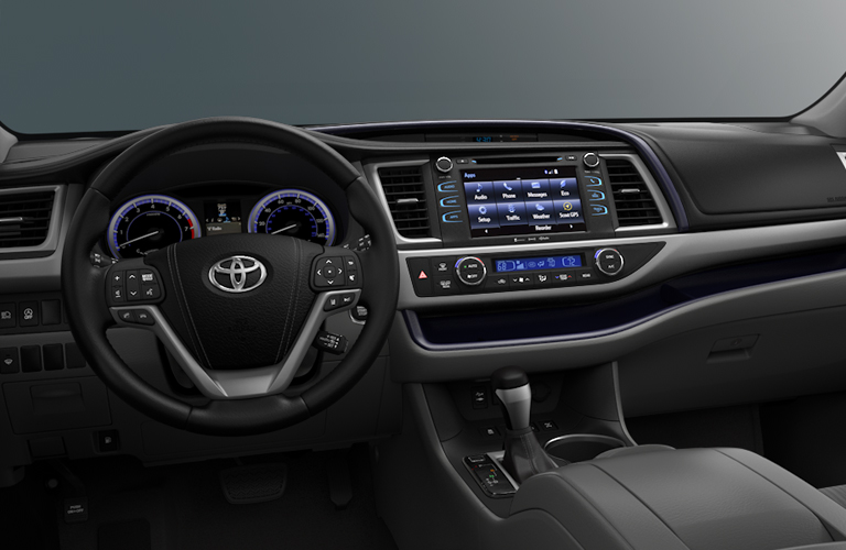 Interior view of the steering wheel and touchscreen of a 2018 Toyota Highlander