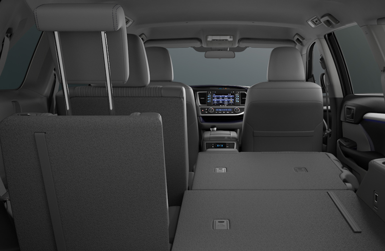 Interior view of 2018 Toyota Highlander showing 60/40 split second and third row of seating
