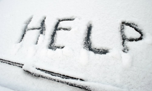 help written in the snow on a windshield above the wipers