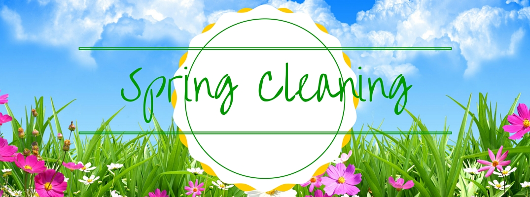 Spring Cleaning written over grass and flowers
