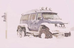 winter driving image with jeep in deep snow