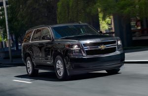 silver chevrolet tahoe on a road