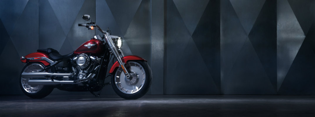 Red 2018 Harley-Davidson FAT BOY motorcycle with a grey industrial background