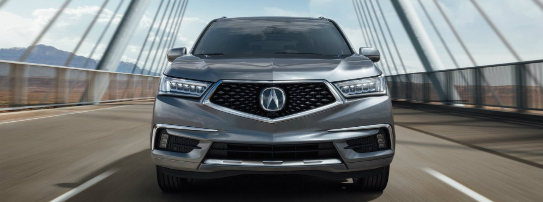 Front view of 2019 Acura MDX driving over bridge