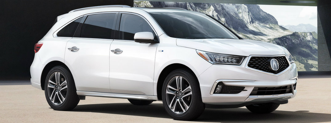 2019 Acura MDX parked in building with mountains in background