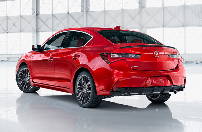 red acura ilx in white room rear view