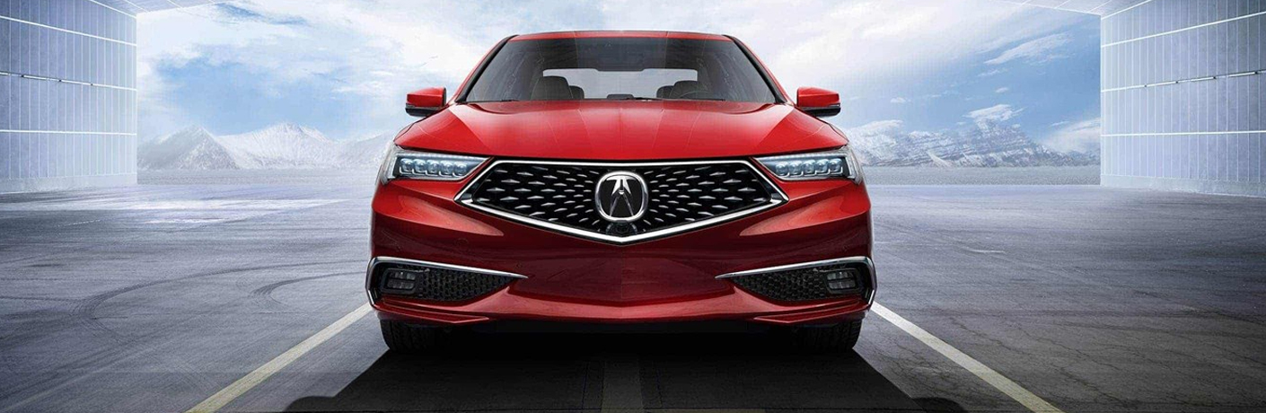 red 2019 acura tlx on road by white mountains