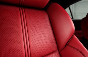 close up of red seating in acura tlx