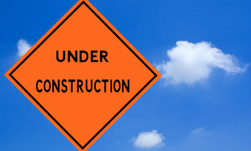 orange under construction road sign