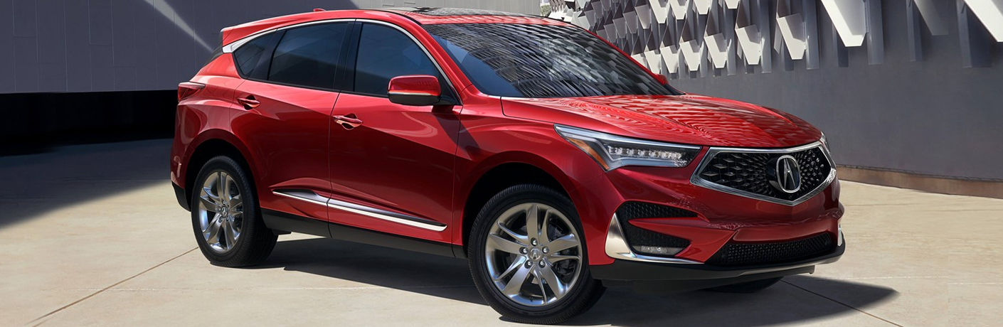 red acura rdx on cement