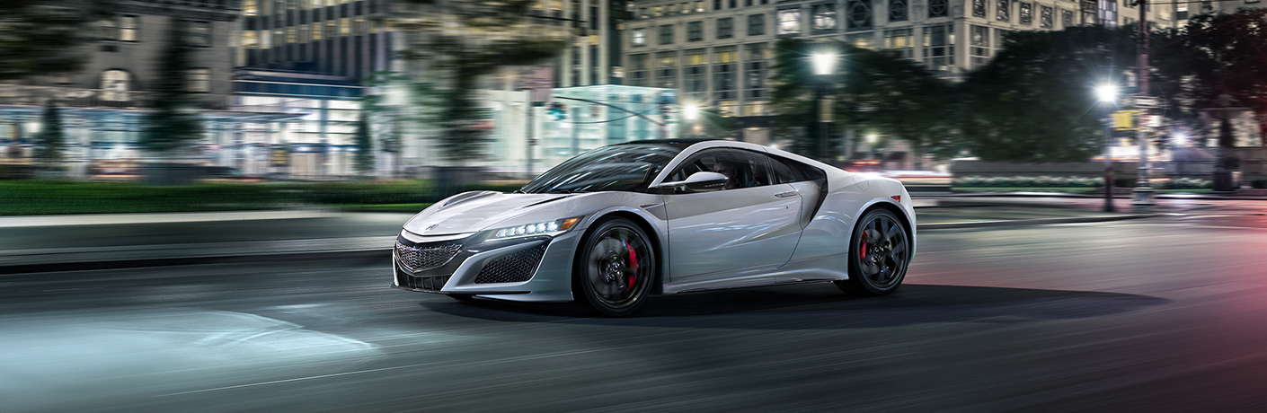 silver acura nsx at night