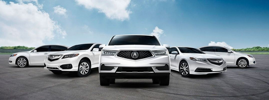 Exterior view of five white Acura models
