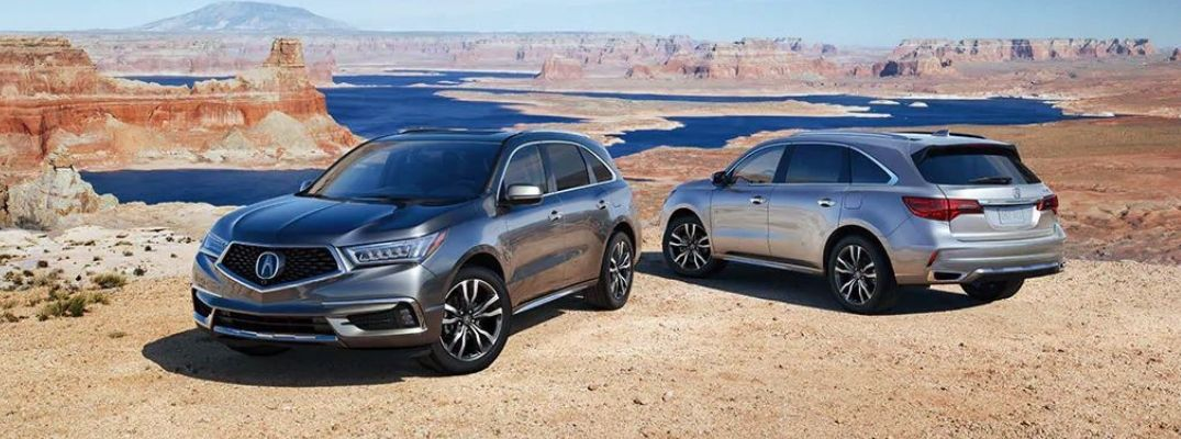 Exterior view of two 2020 Acura MDX models parke in the desert