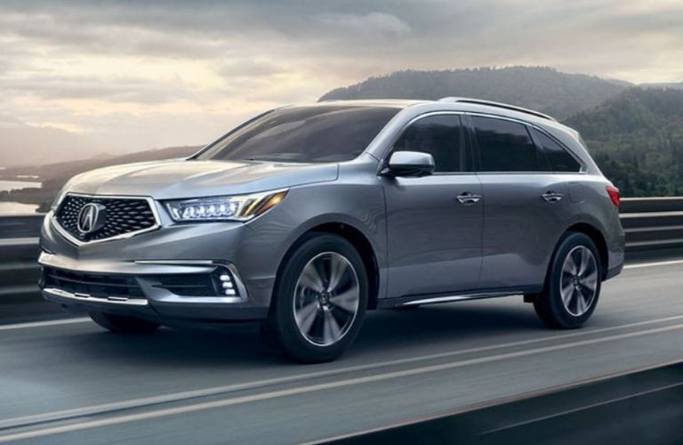 Exterior view of a silver 2020 Acura MDX Sport Hybrid