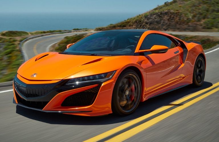 Exterior view of an orange 2020 Acura NSX Sport Hybrid