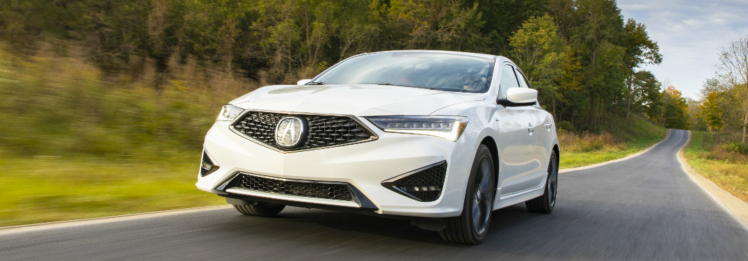 Driver's side front angle view of white 2020 Acura ILX