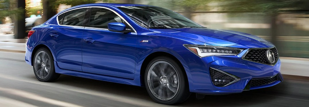 Passenger's side front angle view of blue 2020 Acura ILX