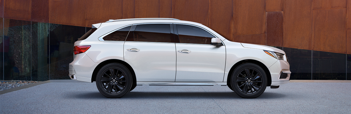 Side view of white 2020 Acura MDX