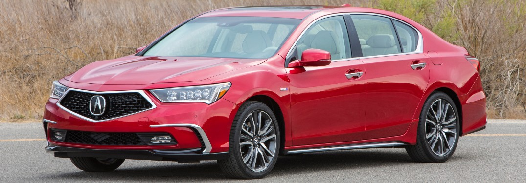 Driver's side front angle view of red 2020 Acura RLX Sport Hybrid