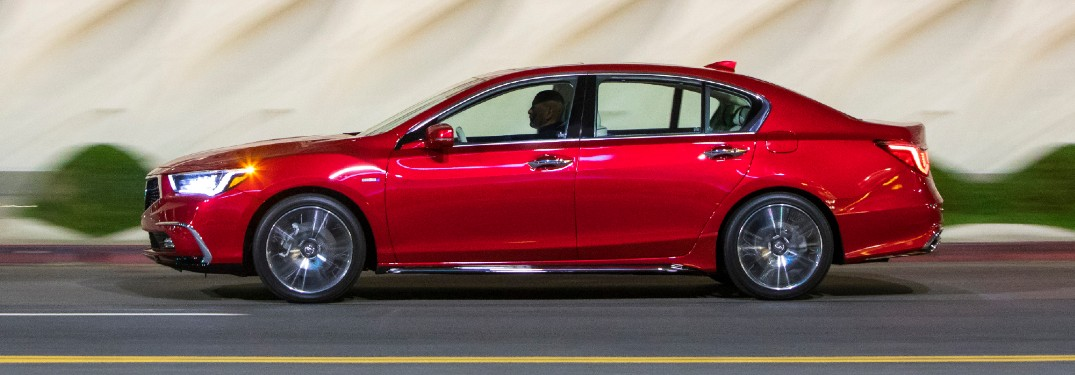 Side view of red 2020 Acura RLX Sport Hybrid