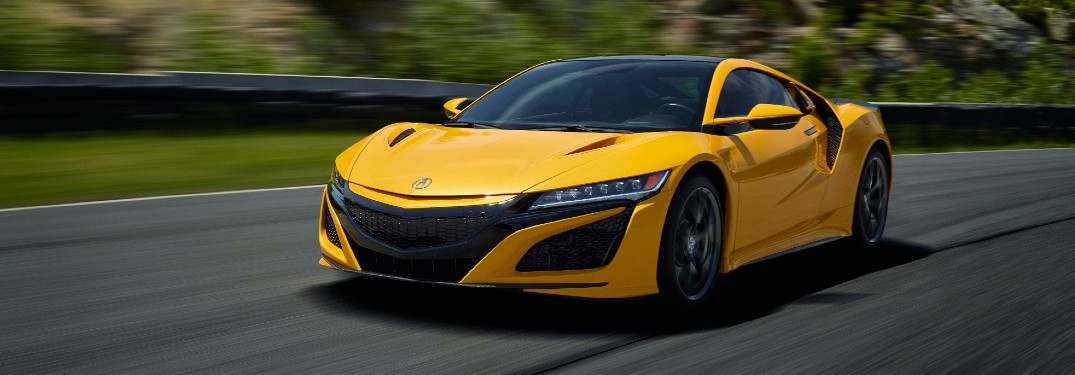 Driver's side front angle view of yellow 2020 Acura NSX