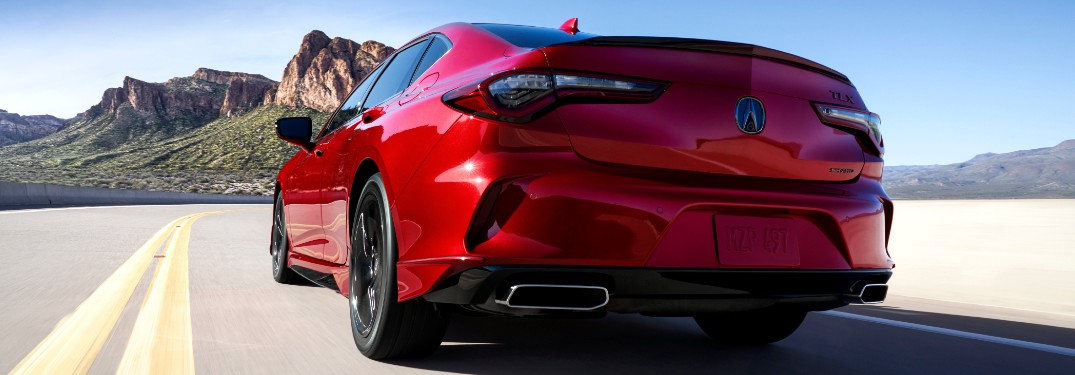 Driver's side rear angle view of red 2021 Acura TLX
