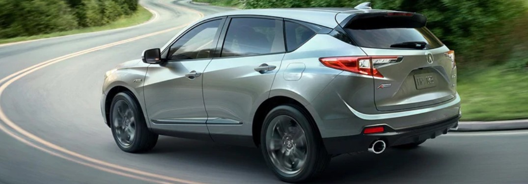 Silver 2020 Acura RDX driving on a curvy road