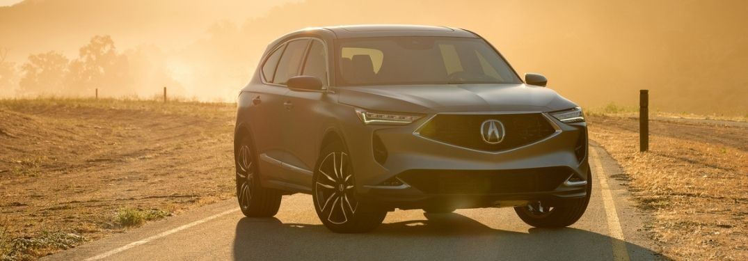 Silver Acura MDX Prototype on a Highway at Sunset